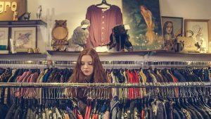 girl looking at clothes racks image
