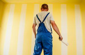 man painting wall image