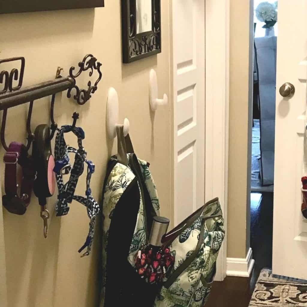 turning closet into mudroom with book bag haning on hook