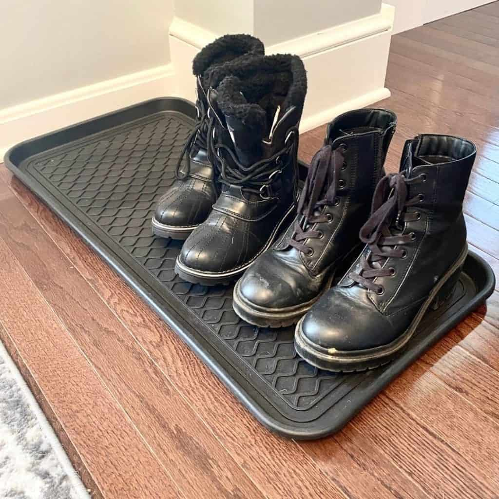 turning closet into mudroom with boots on a black boot tray