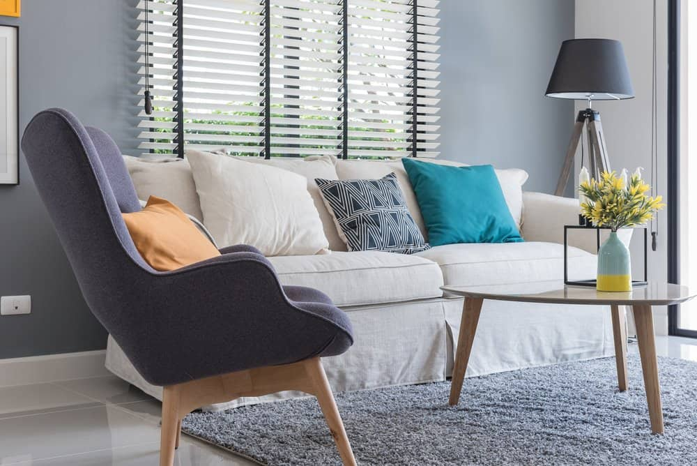 clean living room with sofa, chair, and table