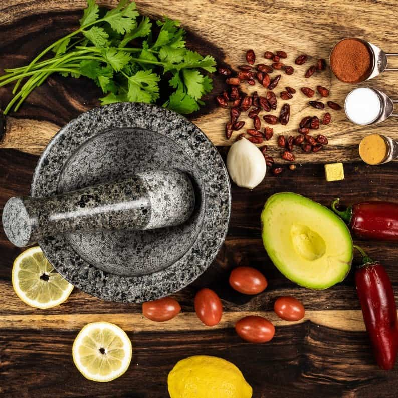 mortar and pestle on tray with food