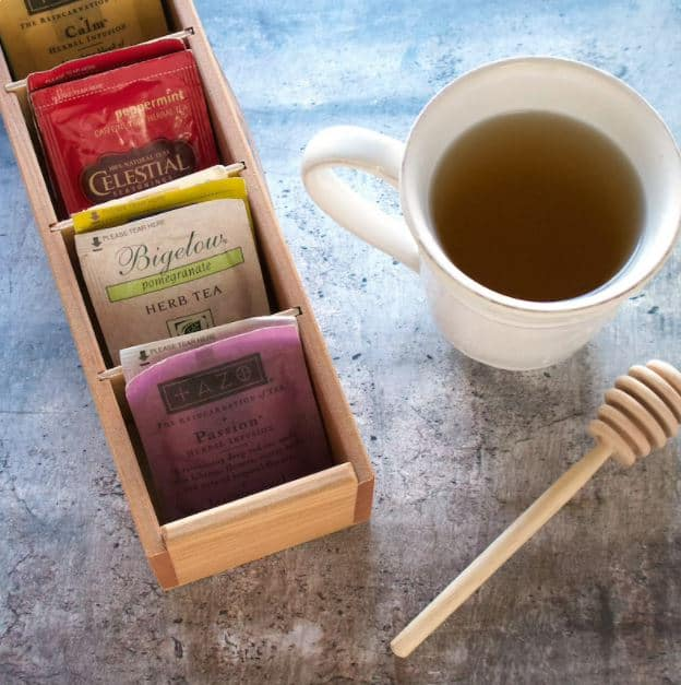 tea organizer with tea cup and honey wand