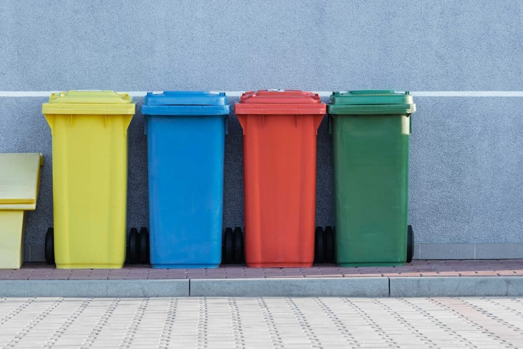 4 garbage  and recycle cans for clutter in colors yellow, blue, red, and green