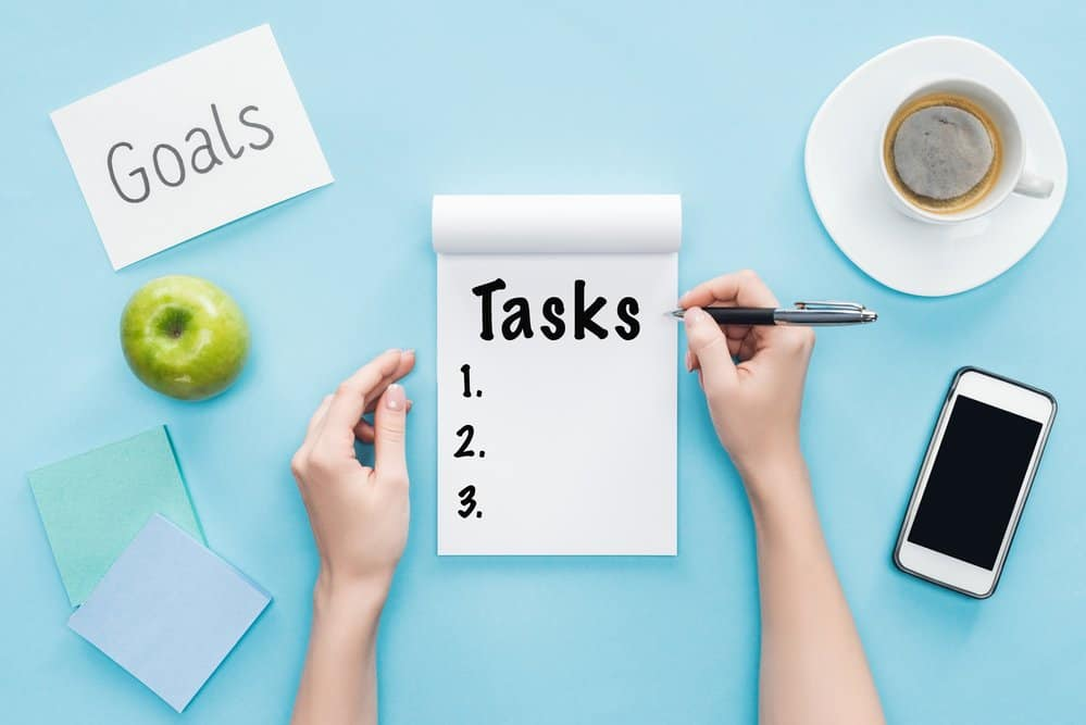 notepad for tasks numbered 1 through three on a blue background