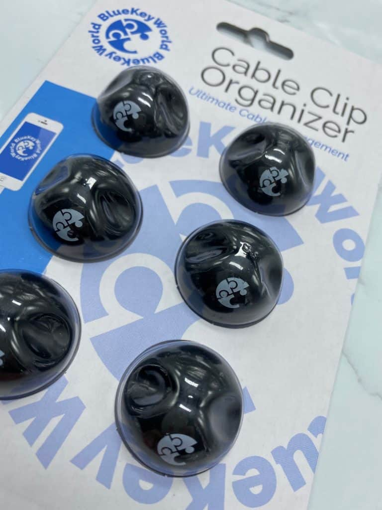 Close up picture of black wire holders in clear bubble packaging background blue and white