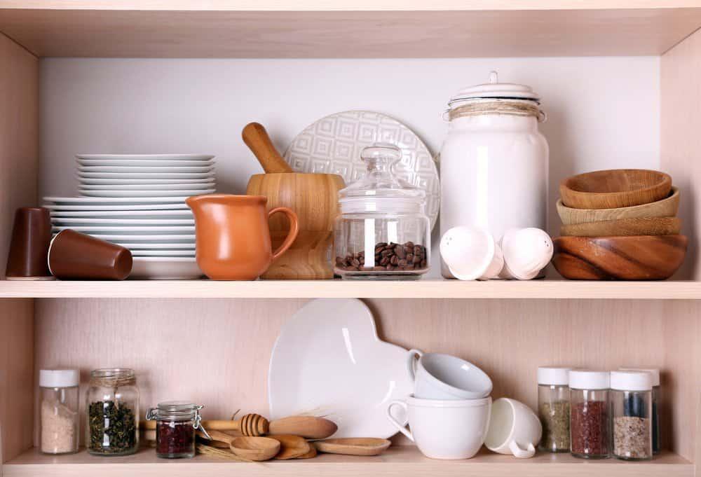 cluttered open kitchen shelves