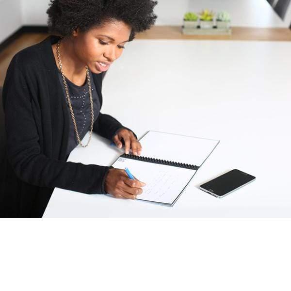 woman using rocketbook erasable notebook
