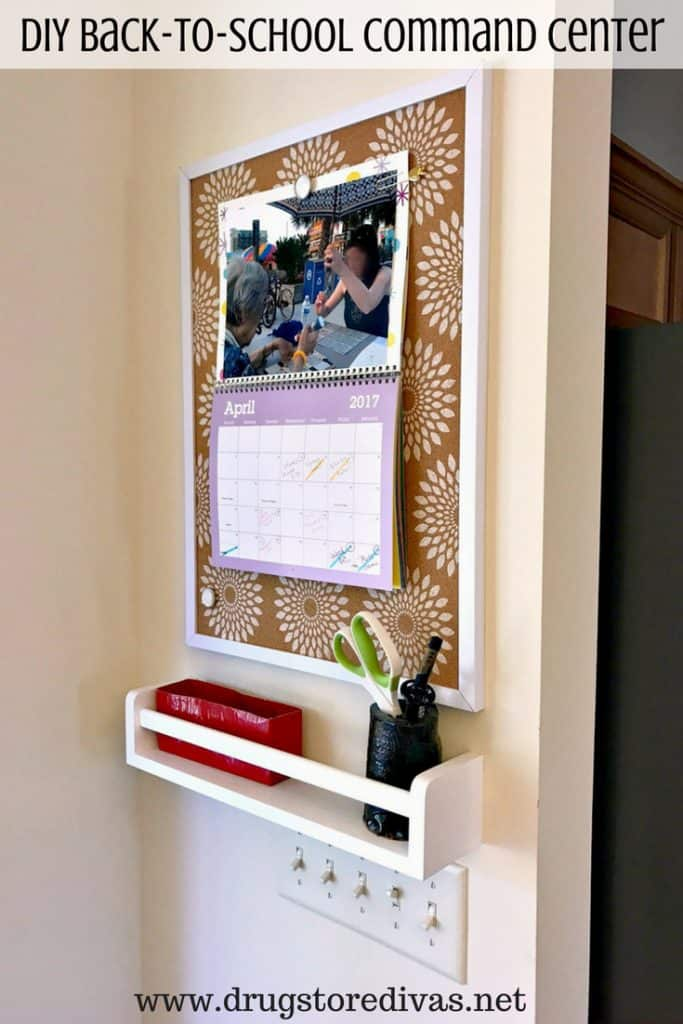 diy command center corkboard with attached calendar and white shelf