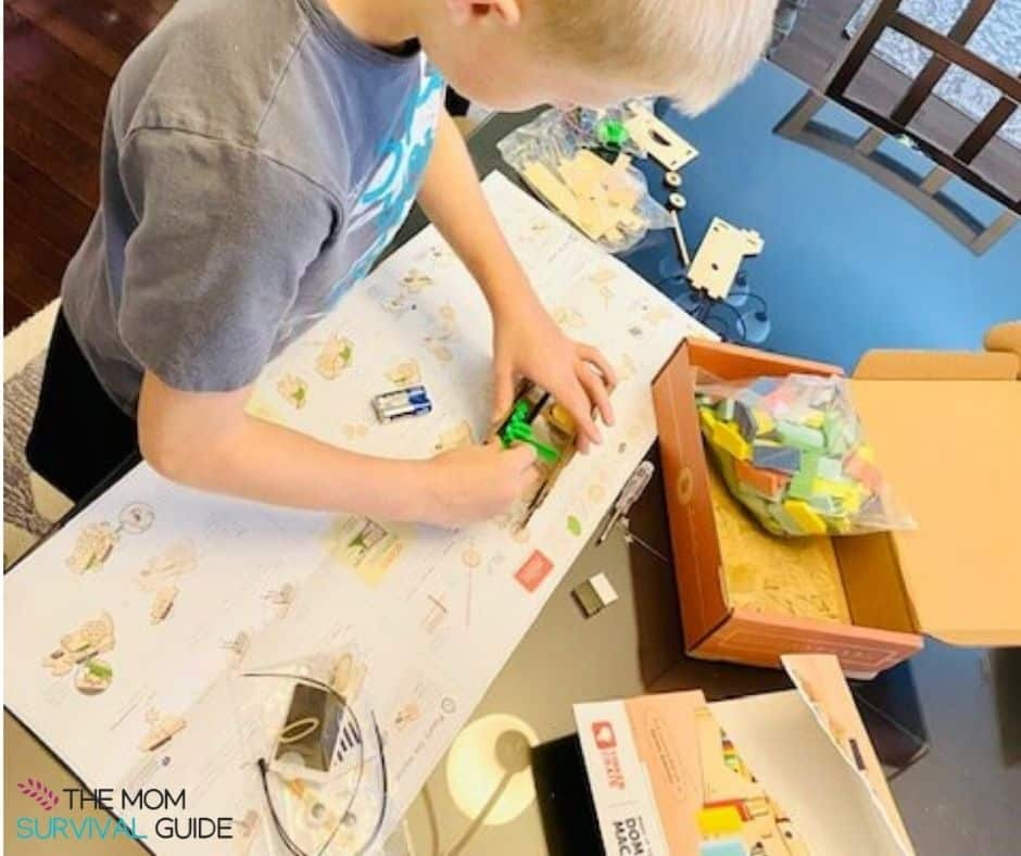 child using best science kit to build