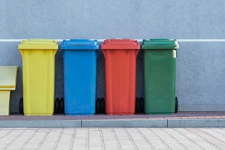 different colored trash bins
