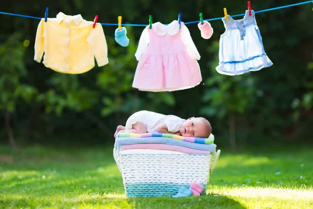 line dry clothes to stop static electricity baby clothes on a line and baby in a basket