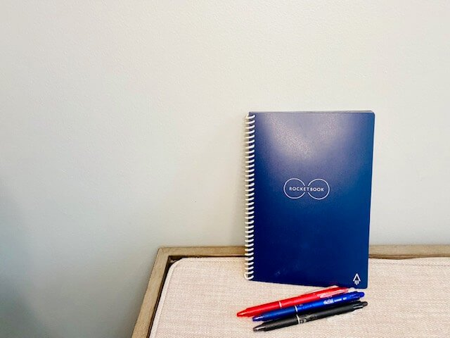 blue rocketbook digital notebook and 3 pens in red blue and black
